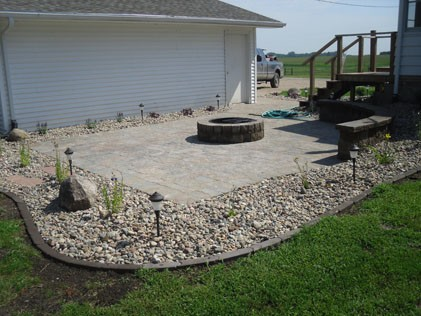 Patio Installation with rockbed surrounding