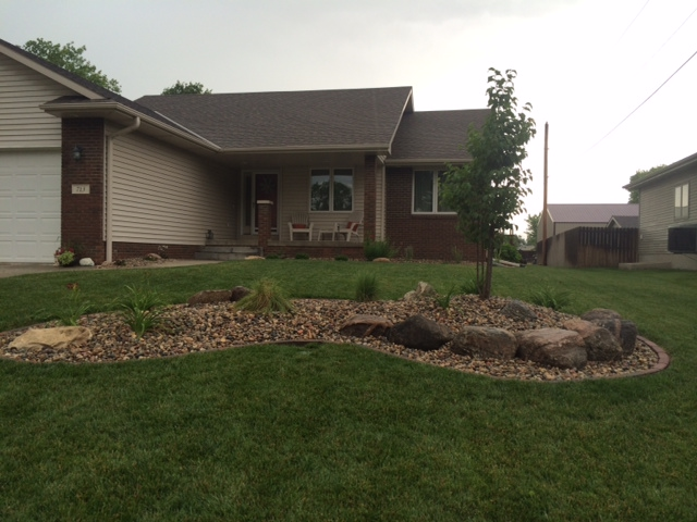 rock bed installation in front yard